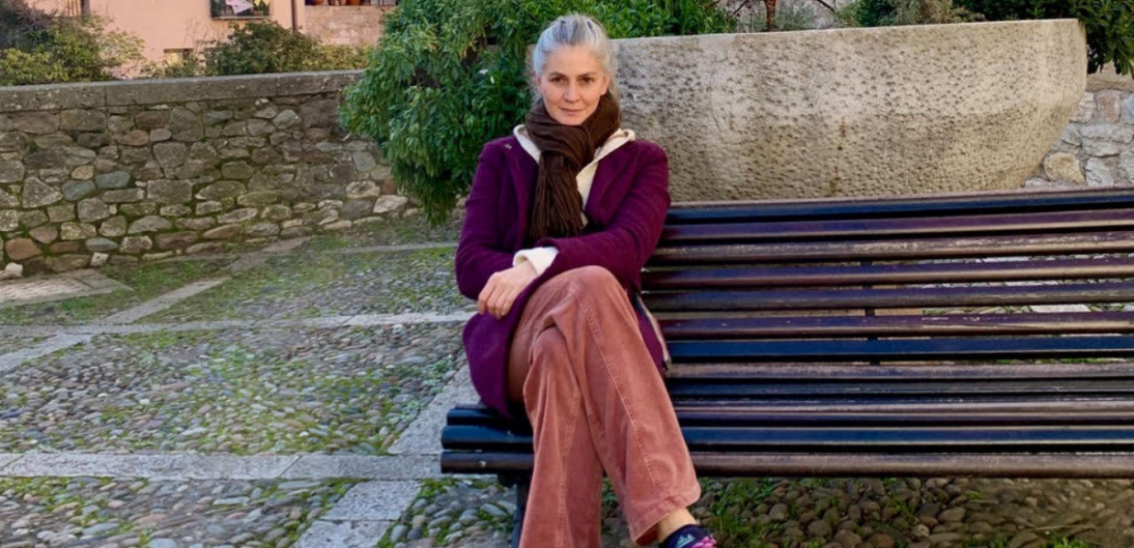A photograph of Maria-Cristina Marinescu sitting on a bench